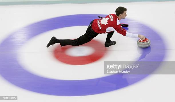 Brad Gushue of Canada throws the stone during the preliminary round of the men's curling between Canada v USA during Day 10 of the Turin 2006 Winter...