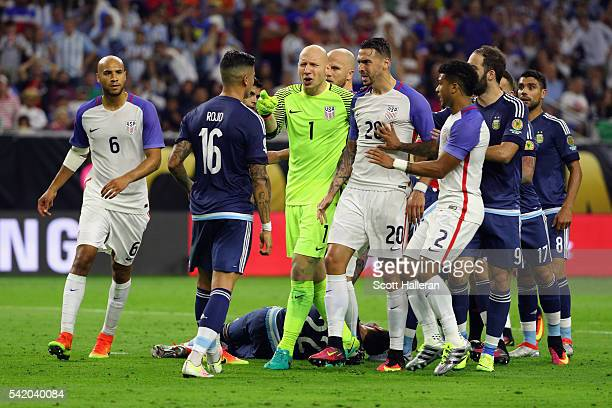 Brad Guzan and Geoff Cameron of United States exchange words with Marcos Rojo of Argentina in the first half during a 2016 Copa America Centenario...