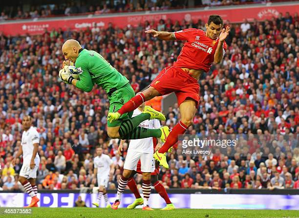 Brad Guzan of Aston Villa claims the ball from Dejan Lovren of Liverpool during the Barclays Premier League match between Liverpool and Aston Villa...
