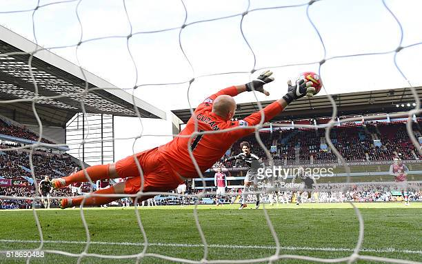 Brad Guzan of Aston Villa dives in vain as Alexandre Pato of Chelsea converts the penalty to score his team's second goal during the Barclays Premier...