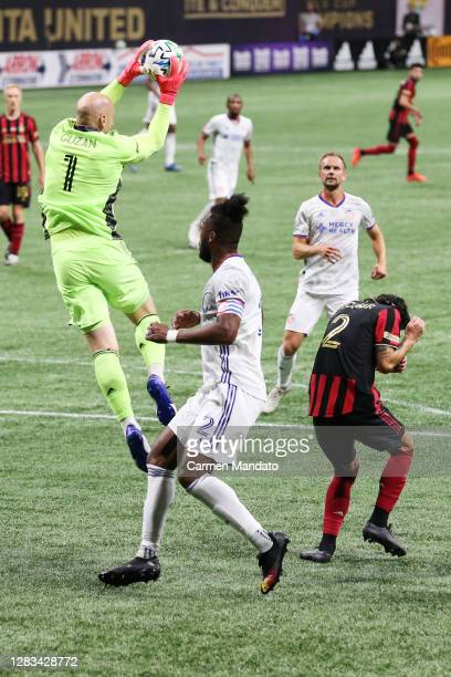 Brad Guzan of Atlanta United catches the ball over Kendall Waston of FC Cincinnati during the second half at MercedesBenz Stadium on November 01 2020...