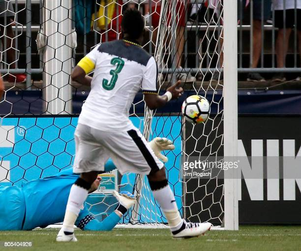 Brad Guzan of the United States makes a save on a penalty kick by Asamoah Gyan of Ghana in the first half during an international friendly between...