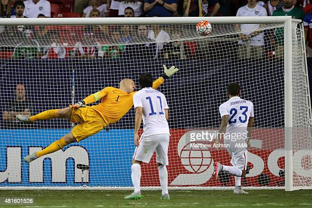 Brad Guzan of United States of America fails to save the bass as a header from Darren Mattocks of Jamaica goes into the net to make it 01 during the...
