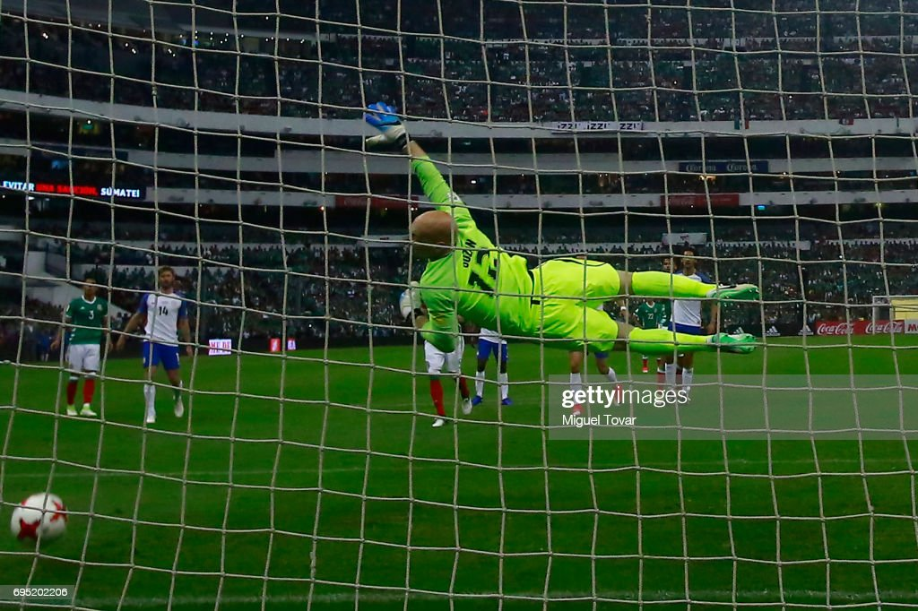 Brad Guzan of US dives for the ball during the match between Mexico and The United States as part of the FIFA 2018 World Cup Qualifiers at Azteca Stadium on June 11, 2017 in Mexico City, Mexico.