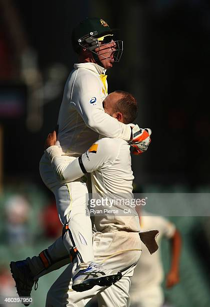 Brad Haddin and Nathan Lyon of Australia celebrate after taking the final wicket of Ishant Sharma of India to claim victory during day five of the...