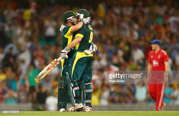Brad Haddin and Shaun Marsh of Australia celebrate winning game three of the One Day International Series between Australia and England at Sydney...