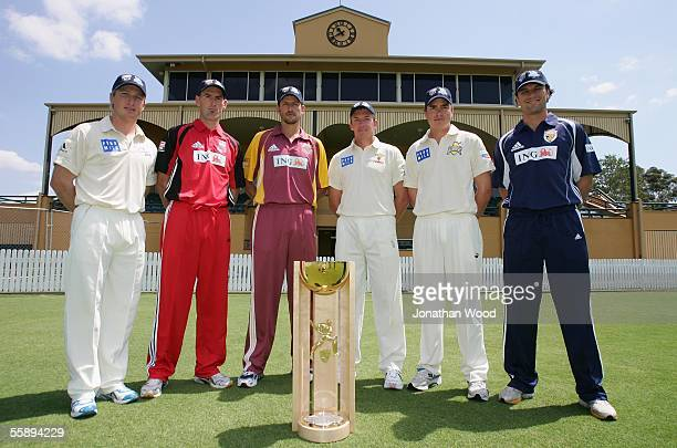 Brad Haddin, Matthew Elliiot, Michael Kasprowicz, Damien Wright, Marcus North and Jonathan Moss pose for a photograph with the Pura Cup at the launch...