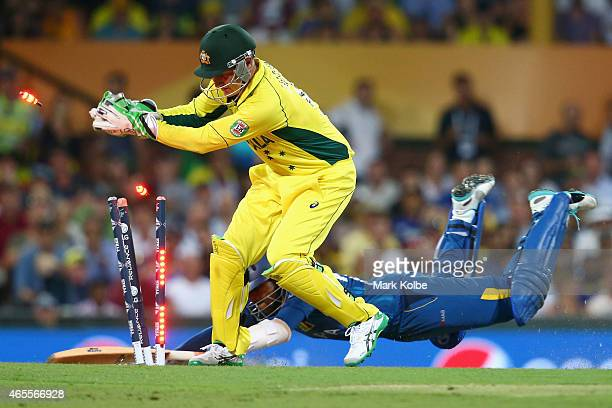 Brad Haddin of Australia attempts to run out a diving Tillakaratne Dilshan of Sri Lanka during the 2015 ICC Cricket World Cup match between Australia...
