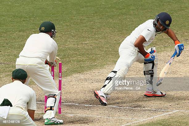 Brad Haddin of Australia attempts unsuccesfully to stump Rohit Sharma of India during day five of the Fourth Test match between Australia and India...