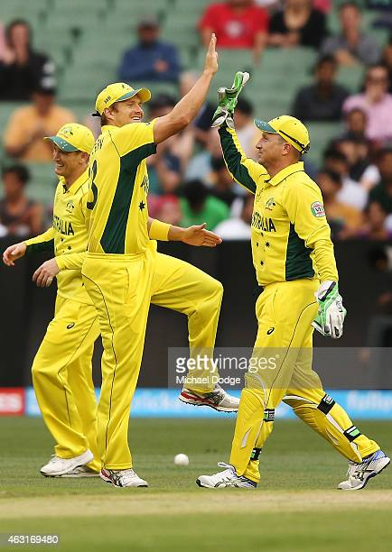 Brad Haddin of Australia celebrates a catch with Shane Watson during the Cricket World Cup warm up match between Australia and the United Arab...