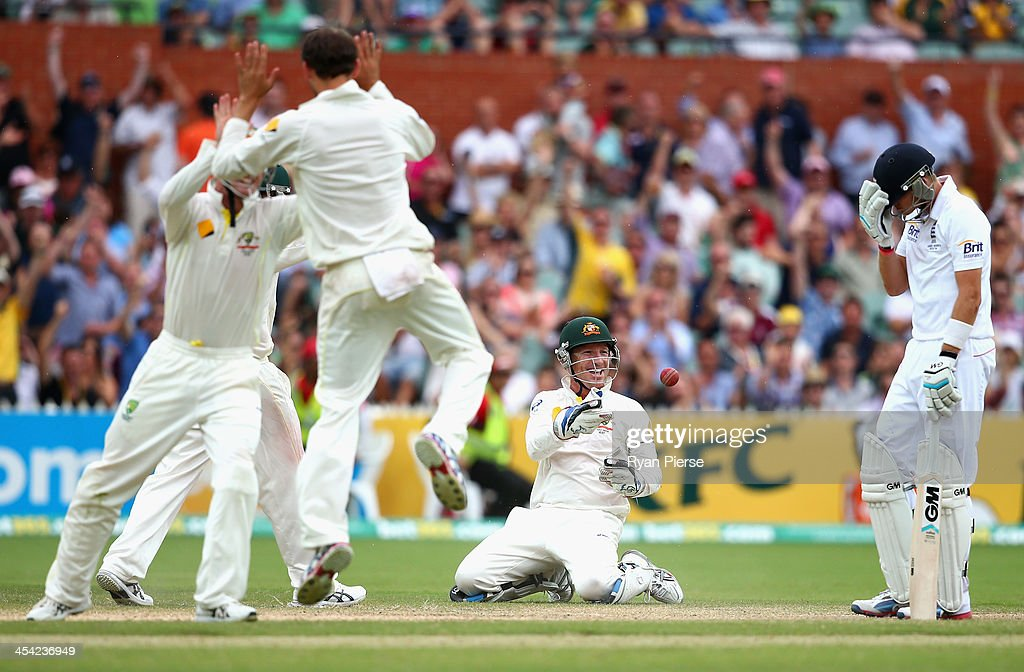 Brad Haddin of Australia celebrates after taking a catch to dismiss Joe Root of England off the bowling of Nathan Lyon of Australia during day four of the Second Ashes Test Match between Australia and England at Adelaide Oval on December 8, 2013 in Adelaide, Australia.
