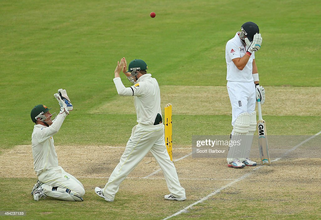 Brad Haddin (L) of Australia celebrates after taking a catch to dismiss Joe Root (R) of England during day four of the Second Ashes Test Match between Australia and England at Adelaide Oval on December 8, 2013 in Adelaide, Australia.