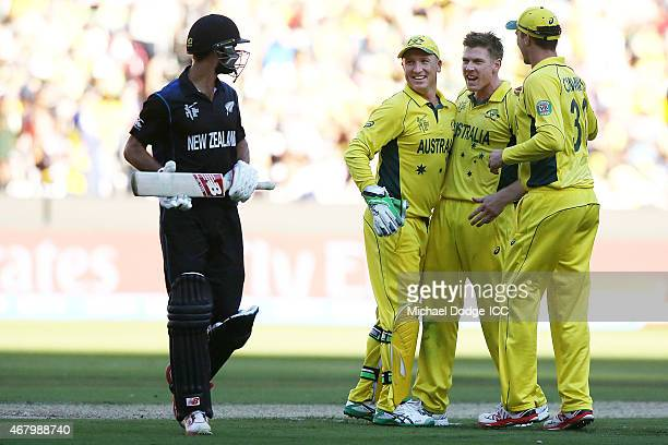 Brad Haddin of Australia celebrates the wicket of Grant Elliott of New Zealand with James Faulkner during the 2015 ICC Cricket World Cup final match...