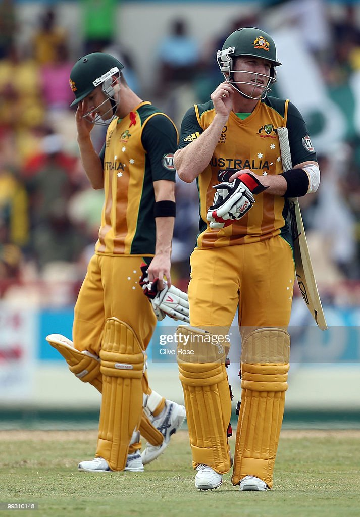 Brad Haddin of Australia leaves the field after being dismissed as Michael Clarke looks on during the ICC World Twenty20 semi final between Australia and Pakistan at the Beausjour Cricket Ground on May 14, 2010 in Gros Islet, Saint Lucia.