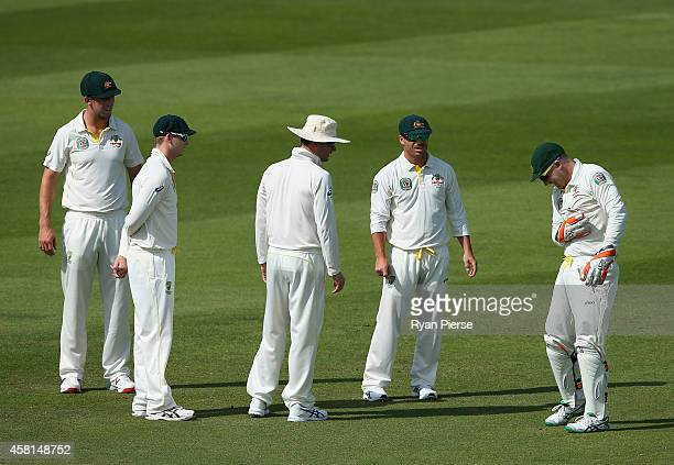 Brad Haddin of Australia recovers after landing heavily on his shoulder during Day Two of the Second Test between Pakistan and Australia at Sheikh...