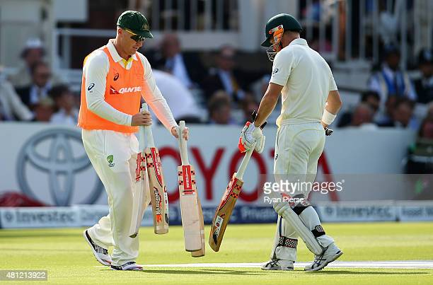 Brad Haddin of Australia runs bats out to David Warner of Australia during day three of the 2nd Investec Ashes Test match between England and...