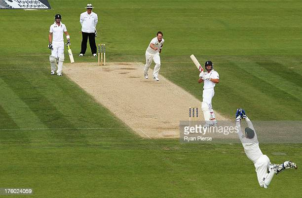 Brad Haddin of Australia takes a catch to dismiss Jonathan Trott of England off the bowling of Ryan Harris of Australia during day three of 4th...