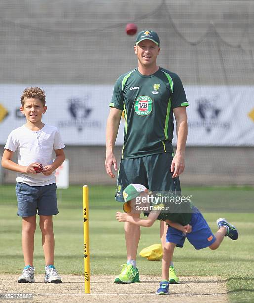 Brad Haddin of Australia watches as his son Zac Haddin bowls in the nets as Zac McDermott son of Australian bowling coach Craig McDermott looks on...