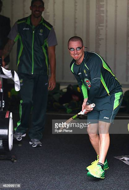 Brad Haddin of Australia wears swimming goggles as rain delays the start of play during the 2015 ICC Cricket World Cup match between Australia and...