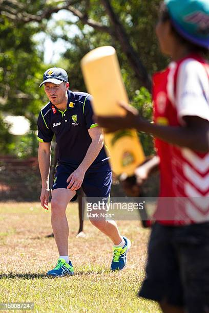 Brad Haddin of the Australian cricket team plays cricket with children during a visit to Pirlangimpi of the Tiwi Islands on August 10 2012 on the...