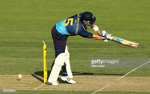 Brad Haddin of the PM's XI is bowled during the International Tour Match between the Prime Minister's XI and West Indies at Manuka Oval on January 29...