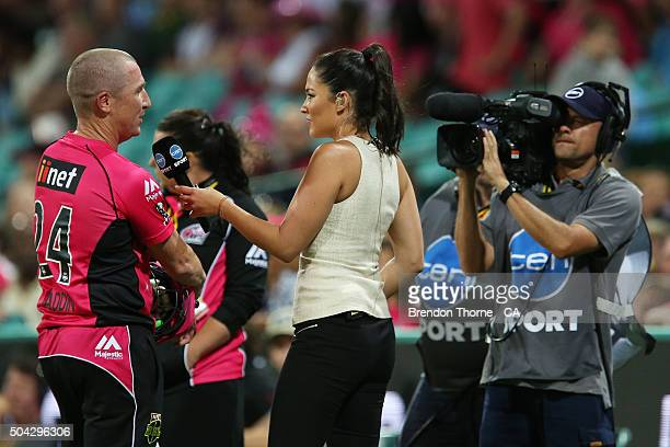 Brad Haddin of the Sixers is interviewed by Mel McLaughlin during the Big Bash League match between the Sydney Sixers and the Brisbane Heat at Sydney...