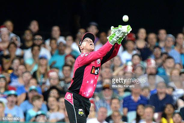Brad Haddin of the Sixers takes the catch to dismiss Jimmy Peirson of the Heat during the Big Bash League semi final match between the Brisbane Heat...