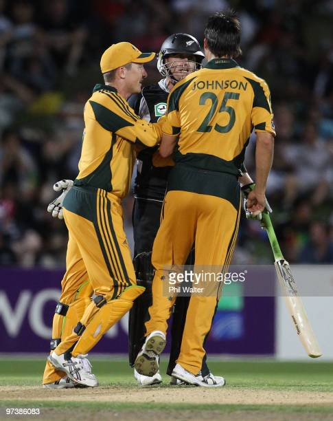 Brad Haddin runs in to seperate Scott Styris of New Zealand and Mitchell Johnson of Australia during an exchange of words during the First One Day...