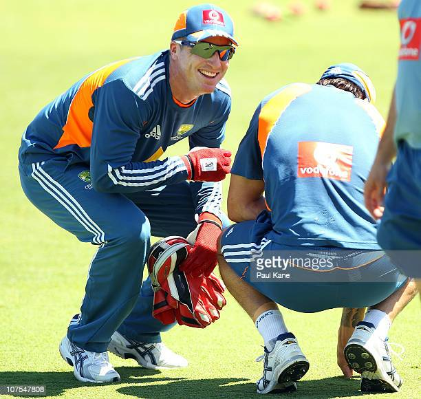 Brad Haddin talks with Mitchell Johnson after he was hit in the groin during an Australian training session at the WACA on December 13 2010 in Perth...