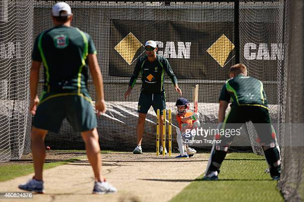 Brad Haddin's son Zac bats in the nets as Ryan Harris David Warner and Nathan Lyon look on during an Australian nets session at Melbourne Cricket...