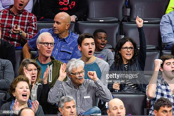 Brad Hall Charles Hall and Julia LouisDreyfus attend a basketball game between the Denver Nuggets and the Los Angeles Clippers at Staples Center on...