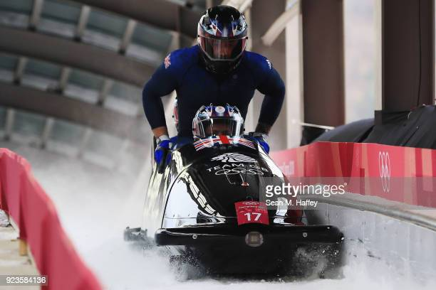 Brad Hall Nick Gleeson Joel Fearon and Greg Cackett of Great Britain react in the finish area during 4man Bobsleigh Heats on day fifteen of the...