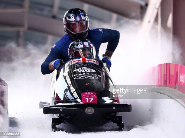 Brad Hall Nick Gleeson Joel Fearon and Greg Cackett of Great Britain finish their run during the 4man Boblseigh Heats on day sixteen of the...