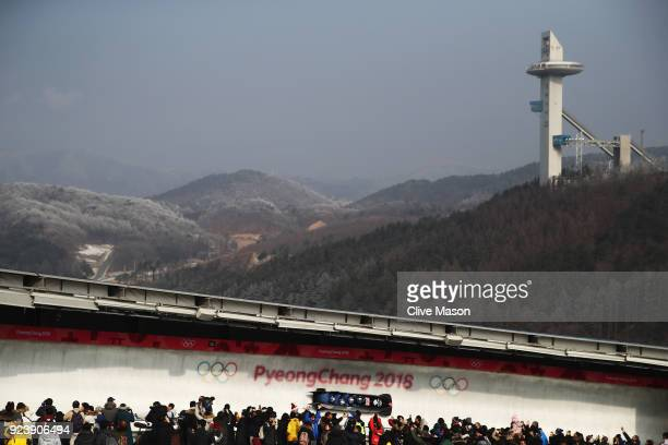 Brad Hall Nick Gleeson Joel Fearon and Greg Cackett of Great Britain make a run during the 4man Boblseigh Heats on day sixteen of the PyeongChang...