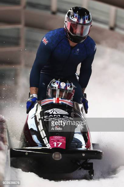 Brad Hall Nick Gleeson Joel Fearon and Greg Cackett of Great Britain finish their final run during the 4man Boblseigh Heats on day sixteen of the...