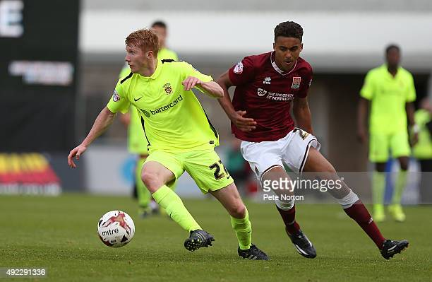 Brad Halliday of Hartlepool United turns with the ball away from Dominic Calvert-Lewin of Northampton Town during the Sky Bet League Two match...