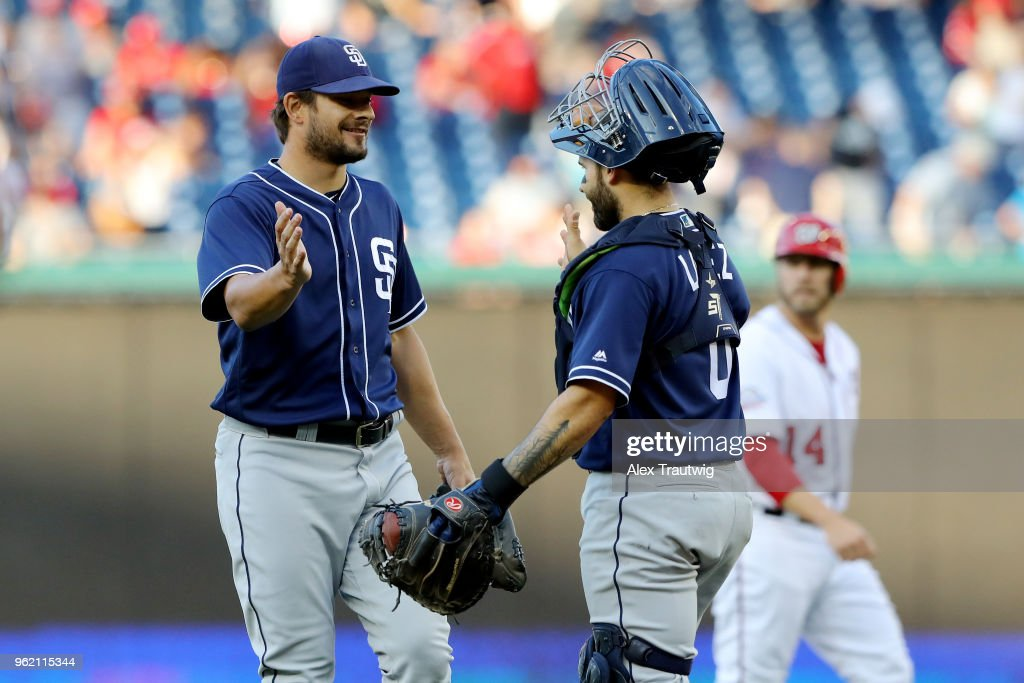 Brad Hand #52 celebrates with Raffy Lopez #0 of the San Diego Padres after defeating the Washington Nationals 3-1 in a game against the Washington Nationals at Nationals Park on Wednesday, May 23, 2018 in Washington, D.C.