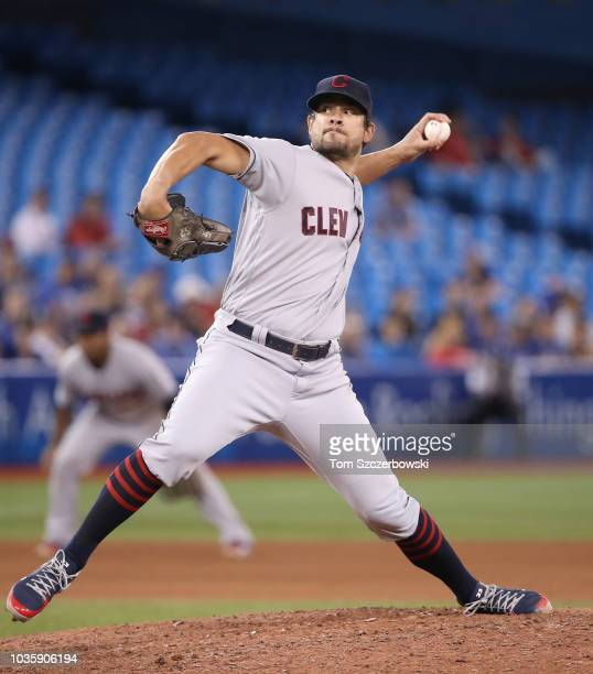 Brad Hand of the Cleveland Indians delivers a pitch in the tenth inning during MLB game action against the Toronto Blue Jays at Rogers Centre on...