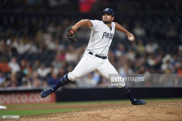 Brad Hand of the San Diego Padres pitches during the ninth inning of a baseball game against the San Francisco Giants at PETCO Park on August 30 2017...