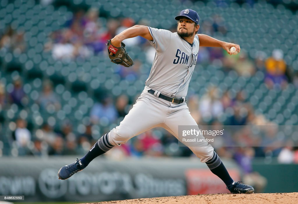 Brad Hand #52 of the San Diego Padres pitches during the ninth inning of a regular season MLB game between the Colorado Rockies and the visiting San Diego Padres at Coors Field on September 17, 2017 in Denver, Colorado.