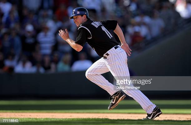 Brad Hawpe of the Colorado Rockies runs the bases after his 2 RBI double that scored Todd Helton and Matt Holliday to give the Rockies a 4-1 eighth...