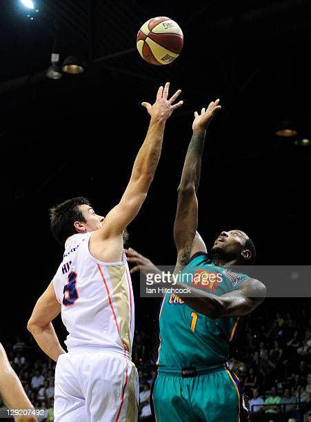 Brad Hill of the Taipans contests the ball with Elvin Mims of the Crocodiles during the round two NBL match between the Townsville Crocodiles and the...