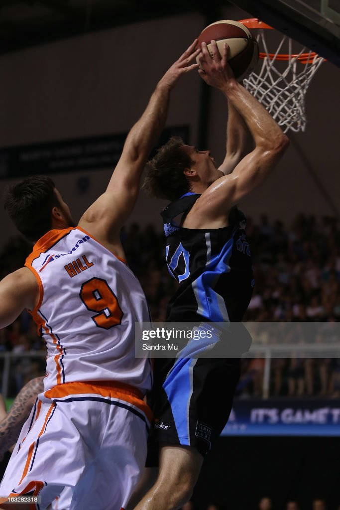 Brad Hill of the Taipans fails to block Tom Abercrombie of the Breakers as he shoots during the round 22 NBL match between the New Zealand Breakers and the Cairns Taipans at North Shore Events Centre on March 7, 2013 in Auckland, New Zealand.