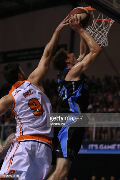 Brad Hill of the Taipans fails to block Tom Abercrombie of the Breakers as he shoots during the round 22 NBL match between the New Zealand Breakers...