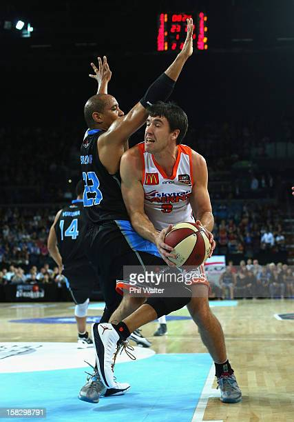 Brad Hill of the Taipans is blocked by CJ Bruton of the Breakers during the round 11 NBL match between the New Zealand Breakers and the Cairns...
