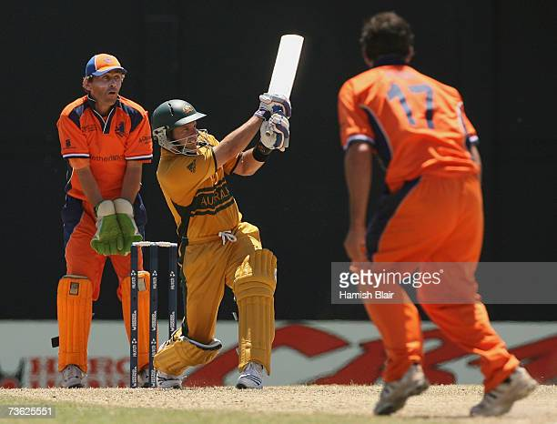 Brad Hodge of Australia hits out off the bowling of Peter Borren of Netherlands with Jeroen Smits of Netherlands looking on during the ICC Cricket...