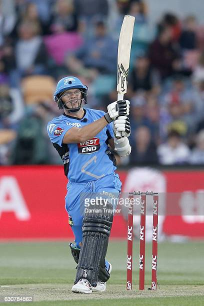 Brad Hodge of the Adelaide Stikers hits a ball for 6 during the Big Bash League match between the Hobart Hurricanes and Adelaide Strikers at...