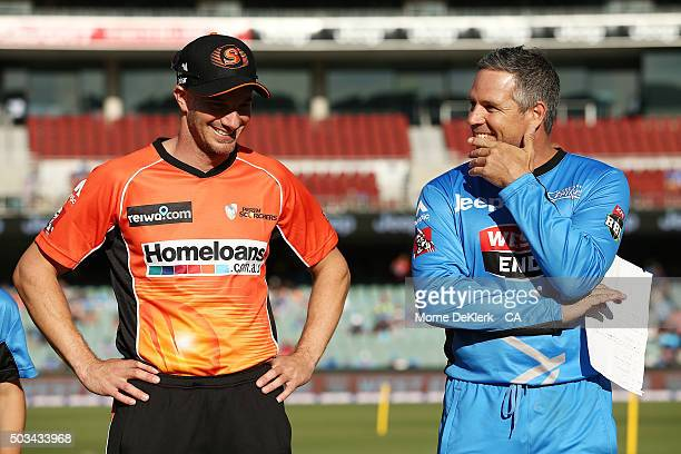 Brad Hodge of the Adelaide Strikers and Michael Klinger of the Scorchers wait to complete the coin toss before the Big Bash League match between the...