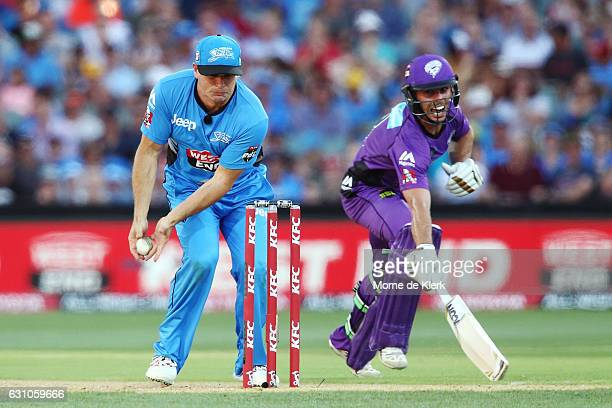 Brad Hodge of the Adelaide Strikers attempts but fails to runout Jonathan Wells of the Hobart Hurricanes during the Big Bash League match between the...