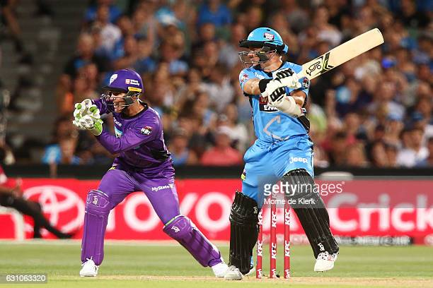 Brad Hodge of the Adelaide Strikers bats in front of Tim Paine of the Hobart Hurricanes during the Big Bash League match between the Adelaide...